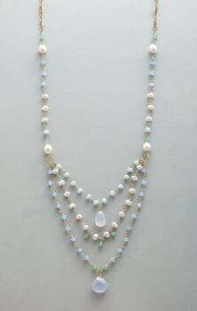 You'll love the spray of oceanic hues on this bold handmade gemstone and pearl necklace.