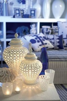 These beautiful lanterns can be an accent throughout every season. Dress up the winter wonderland feel or find yourself next to it on a hot summer night. In porcelain. Carthage Pierced Lantern is size