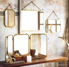 QTY 1 horizontal large   The sinuous curves of these burnished brass mirrors offer a nod to the Art Deco Era. Three sizes of wall mirrors hang from fixed brass chains while a triple panel mirror can hang or stand.