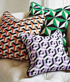 Preppy colors and punchy three-dimensional patterns in the Jonathan Adler 3D Bargello Throw Pillows add a mod touch to any living room sofa.