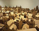 This work consists of a scale model in cardboard of every 'Place of Worship' listed in the 2004 edition of the Edinburgh Yellow Pages telephone directory. The models represent buildings in an area including Lothian, Fife and the Borders. The resulting work is a snapshot of Scotland through its places of religious meeting; churches, cathedrals, synagogues, mosques, Salvation Army halls and temples.