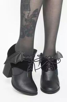 Gothic bat winged ankle boots