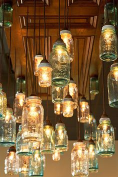 Dinning/Kitchen Area: I like this idea to give WAY more lighting to dark room! Could Wine or Soda Bottles along with Mason Jars. A whole page of jar lights, love that this picture has them hanging from an old door!