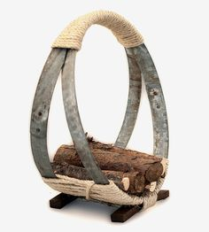 Wine Barrel Hoop Firewood Rack by O'Floinn Decor on Scoutmob