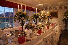 Romantic Intimate Wedding at The Inn at Whitewell We'd arranged four of our Verdi Gris candelabras down the centre of the long table each one was dressed with white Jasmine, Broom, Roses, Freesia, Cymbidium & Dendrobium Orchids, Tulips and Tuberosa, the fragrance heightened by the warmth of the candles was simply heavenly