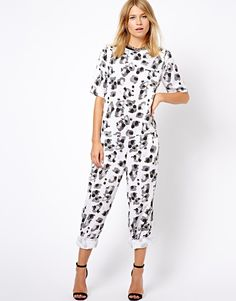 $63, White and Black Print Jumpsuit: Asos Wide Leg Jumpsuit In White Leopard Print. Sold by Asos. Click for more info: http://lookastic.com/women/shop_items/95836/redirect