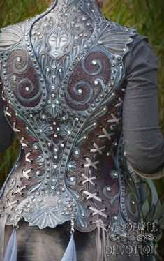 Side Back: Fully hand carved leather armor by Absolute Devotion