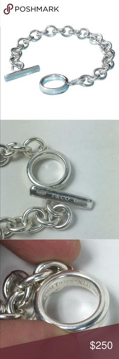 """1837 Chain Toggle 7 1/2"""" Charm Bracelet This is an authentic Tiffany & Co. sterling silver 1837 toggle charm bracelet 36 grams 7 1/2"""" long marked 2004 Tiffany & Co. 925. Item weights 37 grams  The bar is 1"""" long marked 925 T & Co. 1837, the ring is 3/4"""" in diameter and the links soldered smoothly in the joints are 10mm.  Will make a wonderful gift or a great addition to your jewelry collection. Tiffany & Co. Jewelry Bracelets"""