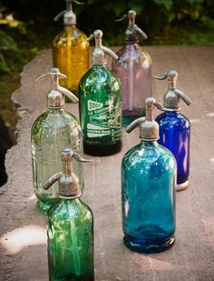 I love these antique water bottles  (French, I think) ....  I only have 1 blue one, but I like this collection
