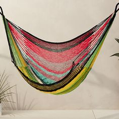Swing under the sun (or stars) in a breezy knit of bright multicolored weather-resistant/ fade-resistant yarn suspended from a swag of hand-knotted fringe.
