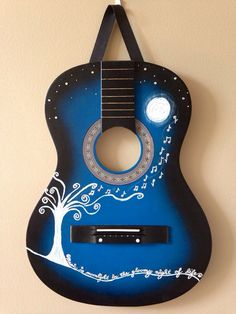"Repurposed guitar wall hanging~  ""music is moonlight in the gloomy night of life""..."