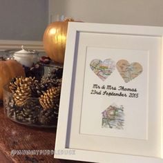 Individually created map art in a frame to mark a couples wedding day in a truly bespoke way. The frame includes a linked heart made up of a map