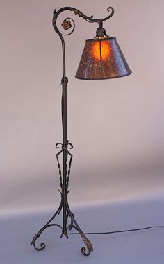 1920s Wrought Iron Bridge Lamp with Amber Mica Shade at 1stdibs