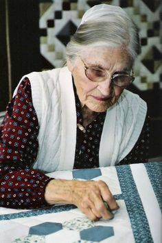 Amish Woman Quilting  Photo Credit: Discover Lancaster TheTourOperator.com