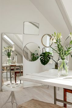 How to make a small room look bigger - white paint and mirrors
