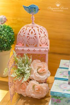 Little Birdies Pink and Blue Party Planning Ideas. Love this pink bird cage for the cake table.