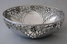 CHARLES ROBERT ASHBEE (1863-1942)  An Arts & Crafts, silver bowl, pierced with a design of fruiting branches
