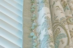 Beautiful curtains. Love the sand color of the edging and the beads. This is the pottery barn pattern on our bed set.  House of Turquoise: Kevin Thayer Interior Design