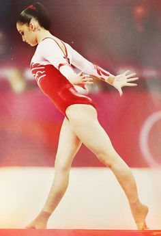 Aliya Mustafina, my favorite gymnast right now. I just love her. I just close my eyes whenever she twists in the air. LOL