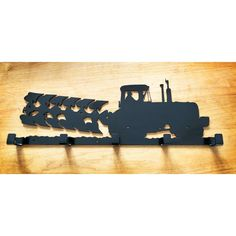 large heavy duty metal tractor and plough coat rack, made from 3mm steel powdercoated black for a tough finish, has 5 coat hooks includes mounting holes.