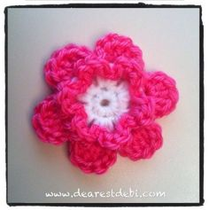 The Simple Crochet Flower is a quick and easy pattern that can be used to embellish your hats or little girls clothes. Pattern is free on my blog. http://dearestdebi.com/simple-crochet-flower
