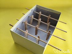 Clothes Pin Foosball PHG3.1 Demonstrate development of fine and gross motor coordination
