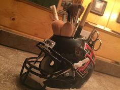 Hey College Football fans!  Browse Different Styles of College Football Desk Caddy Helmets.  The Helmet Caddy is FAN-tastic for Organizing Your Makeup Brushes & Conveniently Storing Tweezers, Nail Clippers, and Grooming Scissors In The Slot Designed to Hold Business Cards!  Get Gift Ideas or Personalize Your Own Desk Caddy While Supporting Your Favorite Team!