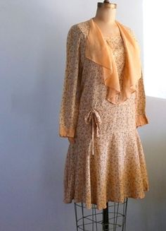 Darling, Cotton Voile, 1920s Flapper Day Dress in a cute yellow floral with a pale peach capelet! It has long sleeves with matching pale peach snap