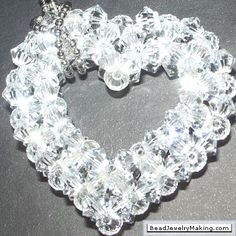 Heart    This Beaded crystal Heart was created using Swarovski Crystal, great for pendant, brooch, earrings and mobile phone accessory. I used white transparent crystals. Made using the right angle weave technique.