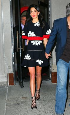 In an Alexander McQueen dress while out for dinner with her parents, sister, and George Clooney at New York City's Caravaggio. - ELLE.com