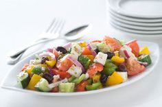 Our Greek Village Salad, otherwise known as a horiatiki salad, is prepared without lettuce.  A staple in Greek homes and restaurants, this traditional salad is brimming with farm-fresh veggies, feta cheese and Kalamata olives.