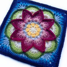 """This 12"""" afghan block is rich in texture, character, and possibility. Endless color combinations can be used to create different floral effects. The gentle cupping of the petals adds subtle dimension and interest. The framing of the flower gives a tile-like effect that will look marvelous repeated or mixed with other afghan blocks."""