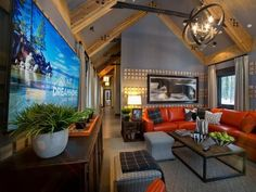 Whether enjoying the impressive mountain vistas or a TV show on the larger-than-life screen, this warm, bright room offers the best of modern mountain living. - Family Room Pictures From HGTV Dream Home 2014 on HGTV