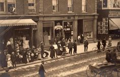 This is the store of Mr. A.J. Stalter, located at 12 Simcoe Street North. 1913.