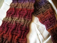 I like the patterns and coloration of this Scarf. Have been getting back into knitting and crocheting. This pattern works for me . Would like to do it in Spring colors too with a lighter yarn. http://knit-easy.blogspot.com/2009/03/new-free-knitting-pattern-ameeta-scarf.html