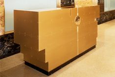 """NY Times critic Hebert Muschamp writes, """"...The reception desk, opposite the elevators, is the remodeling's most striking contemporary feature. An inverted ziggurat of sheet bronze, the desk is Mr. Ranalli's way of welcoming design to the present..."""" Kathryn Bogart Photo."""