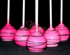 Pink airbrushed Cakepops with black candy coating drizzle by My Cakepops Www.mycakepops.com.au