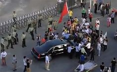 China probes attack on US ambassador's carChina is investigating an incident where about 50 protesters surrounded the car of the US ambassador, tried to block him from entering the embassy compound and ripped the car's flag.  Original