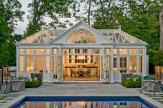 This traditional pool house conservatory has a custom gable glazing pattern and folding-stacking doors. The full kitchen makes this pool house exceptional. Outdoor Rooms, Outdoor Living, Indoor Outdoor, Conservatory Kitchen, Conservatory Design, Victorian Conservatory, Victorian House, Pool House Designs, Pool House Plans