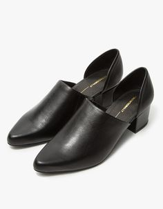 Slip-on heel from Intentionally Blank in Black. Slightly higher vamp than original Perf. Pointed toe. Concealed elastic goring at inside vamp. Leather lining. Padded footbed. Leather-wrapped block heel with rubber cap.  • Leather upper • Leather sole