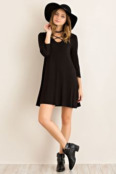 Cute tee shirt dress featuring round neckline with criss-cross strap details. Knit. Lightweight. 96% Viscose 4% Spandex Made in USA