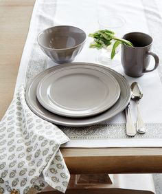 Modeled after the rimmed dishes served in French cafés, this Brigitte stoneware collection brings sophistication to the table with subtle details and earthy, washed hues. Mix and match pieces for a lovely tonal palette.