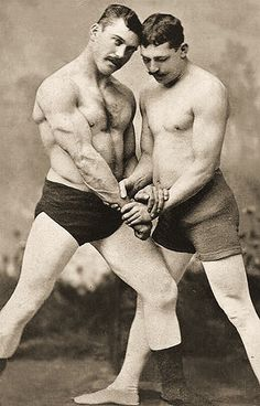 Old timey wrestlers....Look as tough as the guys today and they didn't even have Steroids like they're all on today!