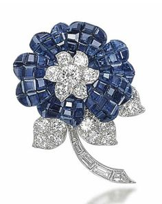A MYSTERY-SET SAPPHIRE AND DIAMOND FLOWER BROOCH, BY VAN CLEEF & ARPELS   Designed as a mystery-set sapphire flower blossom centering upon a brilliant-cut diamond cluster pistil and extending three diamond-set leaves and a baguette-cut diamond stem, mounted in platinum and gold, 4.0 cm  Signed Van Cleef & Arpels, no. 31861