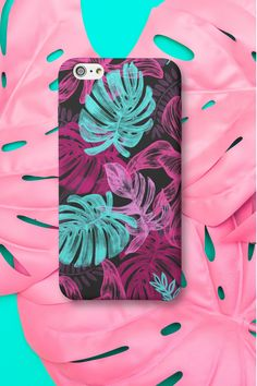 Arguably one of the most popular design trends currently, leaf and palm prints offer more than just another decor style. They allow us to live in a tranquil, tropical oasis. But these designs can make also a phone case very special! This stunning phone case is available for iPhone and Samsung. #phonecases #phonecovers #tropicalplantsphonecase #iphonecase #samsungcase Samsung Cases, Iphone Cases, Tropical Plants, Phone Covers, Oasis, Decor Styles, Design Trends, Palm, Popular