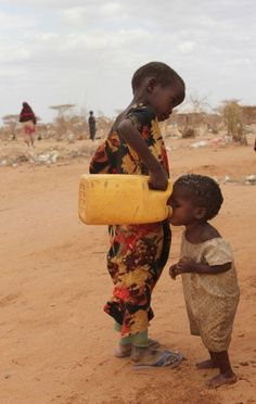 Poor African kids drinking water. Love this picture so much..Thank you.