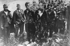 Captured Slovenian partisans are led by soldiers to their execution.