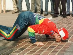 Gordon kisses bricks at Indianapolis Motor Speedway after winning the Brickyard 400 for the second time on Aug. 1, 1998.