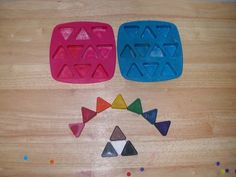 "Use Ikea ""Plastis"" triangle ice cube trays to melt down and reshape your broken crayon collection. Sort them into a rainbow, put them in tin cans from the recycling bin and melt them in hot water."