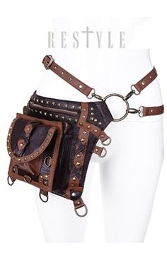 brown faux leather bag from Restyle. This gorgeous bag is covered in eye catching details, including pyramid studding, detachable buckles, and leather straps. Totally versatile, this bag can be styled and worn in various ways.